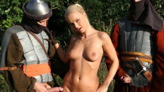 Nasty blonde beauty gets hardcore fucked by two knights outdooes