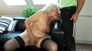 Sweet old chick Norma is fucking with a younger boy Thumbnail