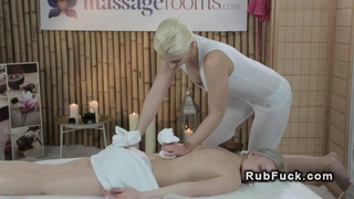 Blonde gives massage with vibrator