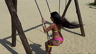 Playful babe swings outdoor at the beach Thumbnail