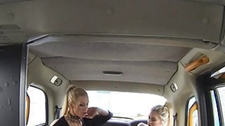 Blonde gets big tits massaged in cab