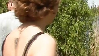 Ginger haired babe is taken to the lake shore and fucked Thumbnail