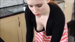 Pale redhead beauty shows her big jugs in the kitchen Thumbnail